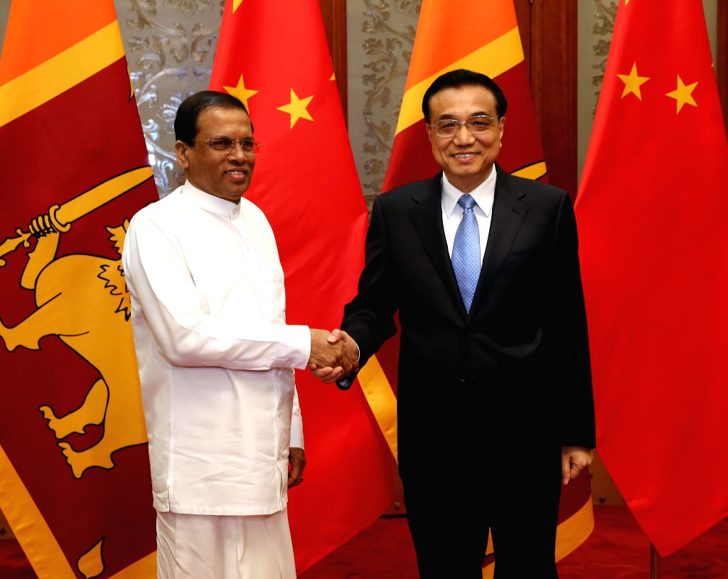 Chinese Premier Li Keqiang (R) meets with Sri Lanka President Maithripala Sirisena, who will also attend the annual conference of the Boao Forum for Asia, in ...