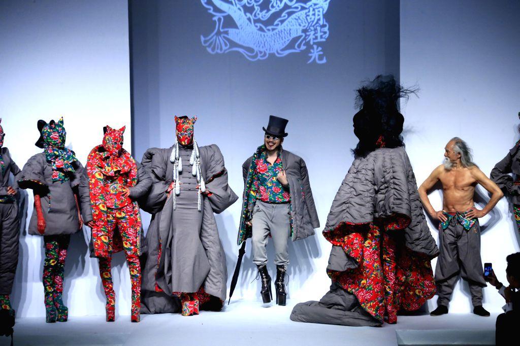 Models present creations of Sheguang Hu during the China Fashion Week Autumn/Winter 2015/2016 in Beijing, capital of China, March 25, 2015. (Xinhua/Li ...