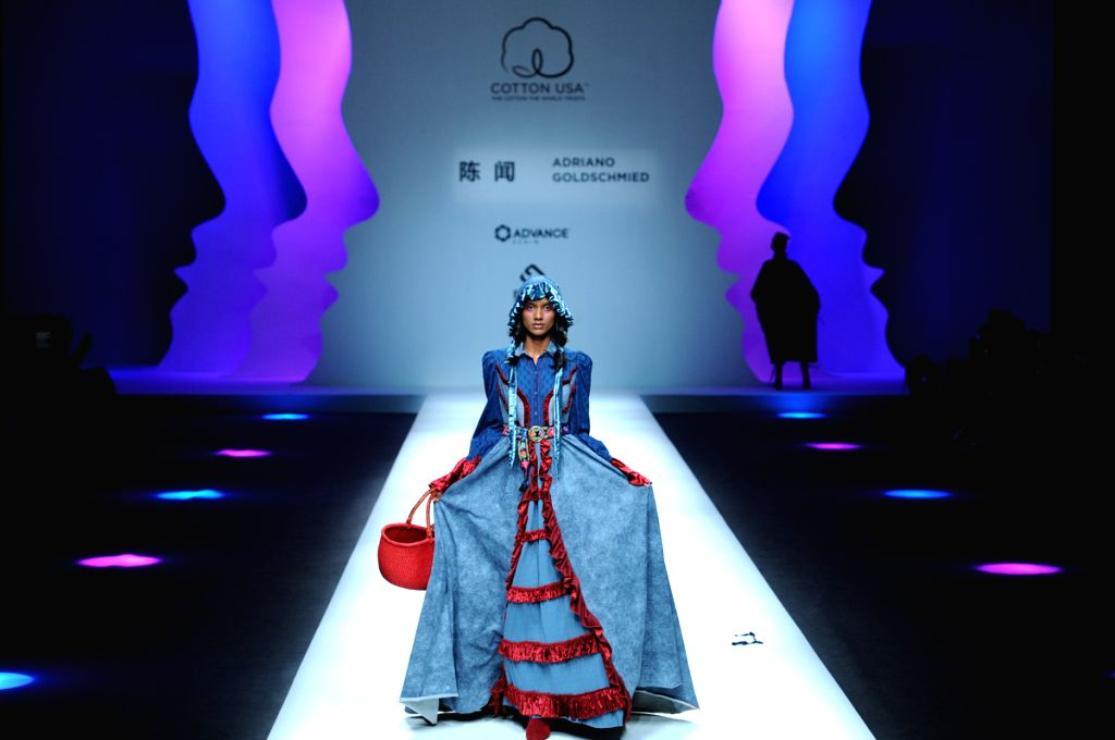 BEIJING, March 28, 2018 - A model presents a creation designed by Chen Wen and Adriano Goldschmied in the COTTON USA collection of the China Fashion Week in Beijing, capital of China, March 28, 2018.