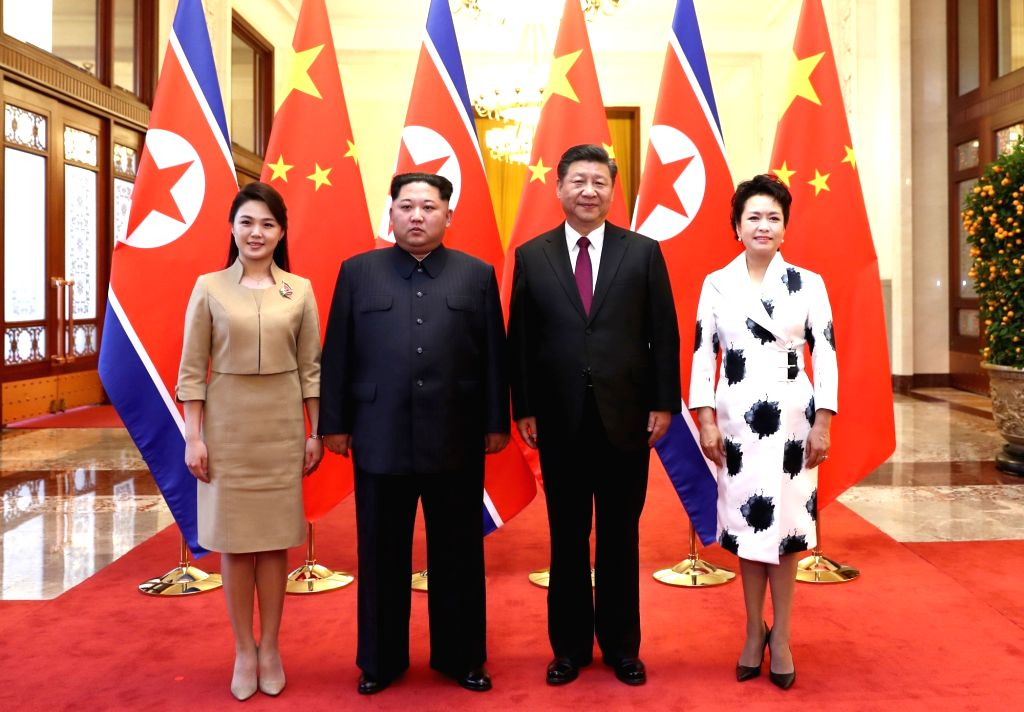 BEIJING, March 28, 2018 - Xi Jinping (2nd R), general secretary of the Central Committee of the Communist Party of China (CPC) and Chinese president, and his wife Peng Liyuan (1st R) meet with Kim ...