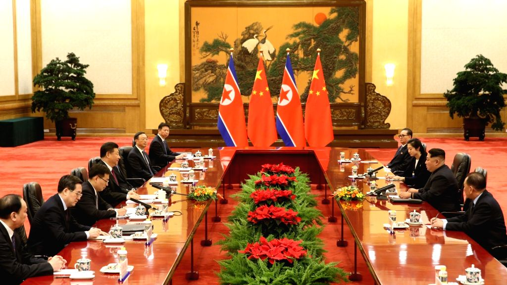 BEIJING, March 28, 2018 - Xi Jinping, general secretary of the Central Committee of the Communist Party of China (CPC) and Chinese president, holds talks with Kim Jong Un, chairman of the Workers' ...