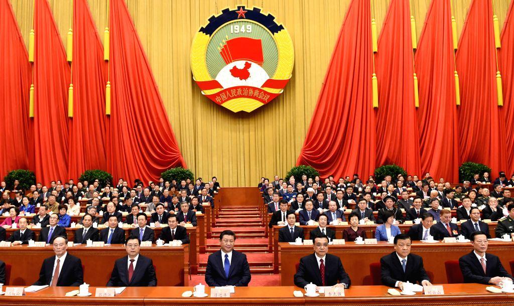 Xi Jinping (3rd L, front),  Li Keqiang (3rd R, front), Zhang Dejiang (2nd L, front), Liu Yunshan (2nd R, front), Wang Qishan (1st L,front) and Zhang Gaoli (1st R, ...