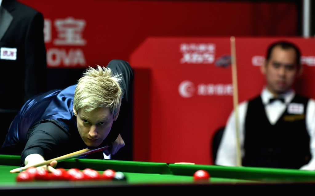 Neil Robertson of Australia competes during the first round match against Dechawat Poomjaeng of Thailand at the 2015 World Snooker China Open in Beijing, capital ...