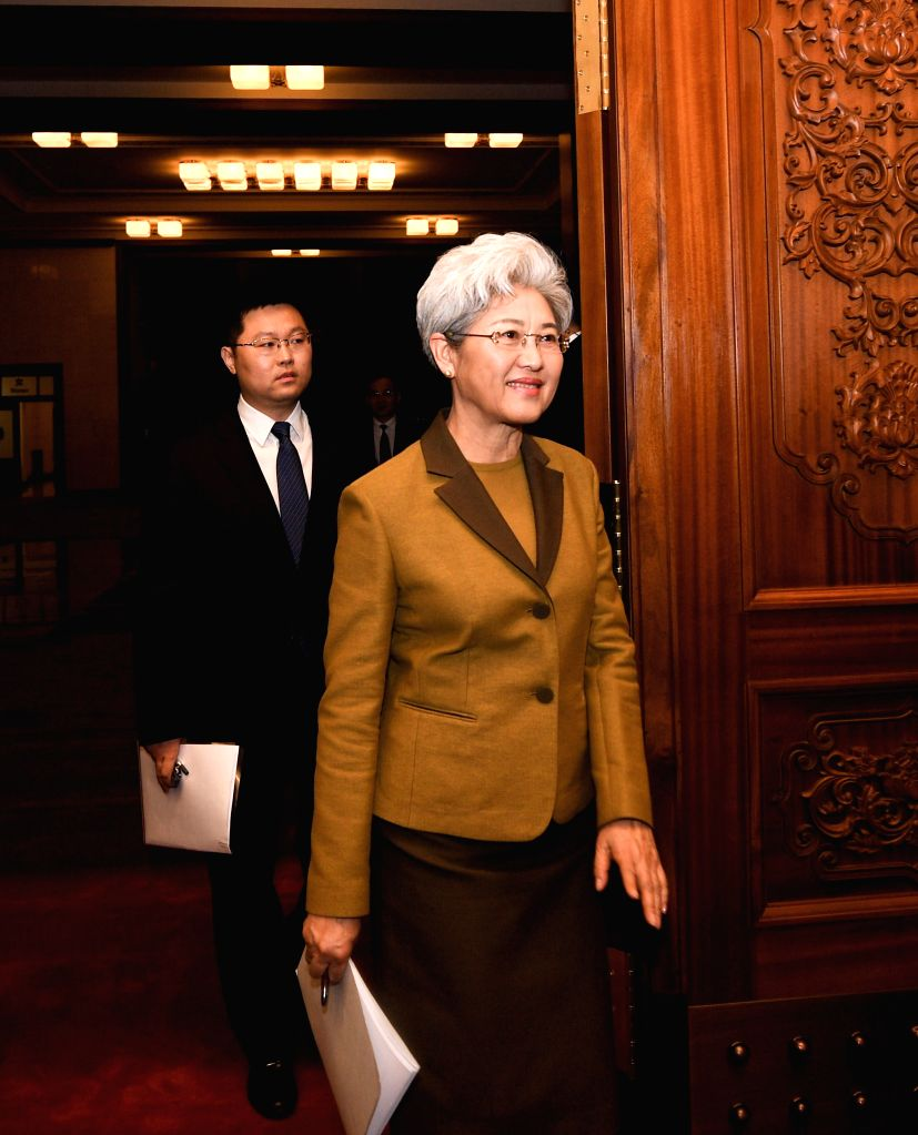 BEIJING, March 4, 2017 - Fu Ying (R), spokesperson for the fifth session of China's 12th National People's Congress (NPC), arrives for a press conference on the session at the Great Hall of the ...