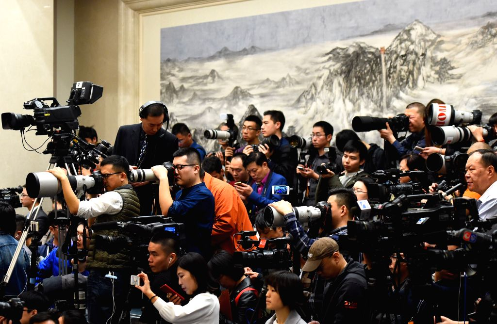 BEIJING, March 4, 2017 - Journalists work during the press conference on the fifth session of China's 12th National People's Congress (NPC) at the Great Hall of the People in Beijing, capital of ...