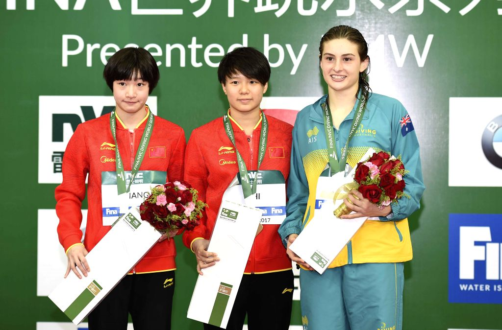 BEIJING, March 4, 2017 - Silver medalist Chang Yani of China, her teammate gold medalist Shi Tingmao and bronze medalist Maddison Keeney of Australia (L to R) react during the awarding ceremony for ...