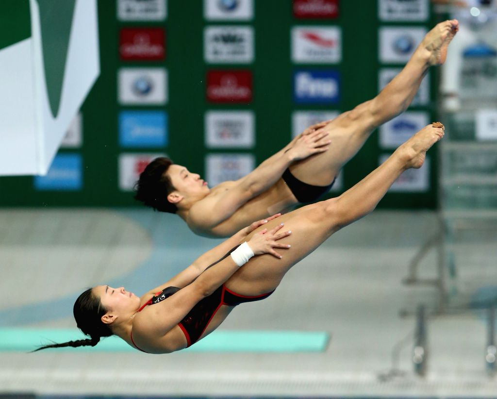 BEIJING, March 4, 2017 - Wang Han (front)/Li Zheng of China compete during the mixed 3m springboard synchro final of the FINA Diving World Series 2017 in Beijing, capital of China, March 4, 2017. ...