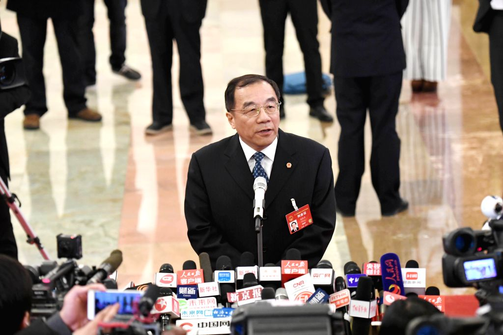 BEIJING, March 5, 2017 - Chinese Minister of Supervision Yang Xiaodu receives an interview after the opening meeting of the fifth session of the 12th National People's Congress at the Great Hall of ...