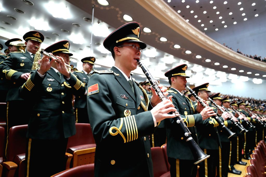 BEIJING, March 5, 2017 - The military band of Chinese People's Liberation Army plays the national anthem during the opening meeting of the fifth session of China's 12th National People's Congress ...