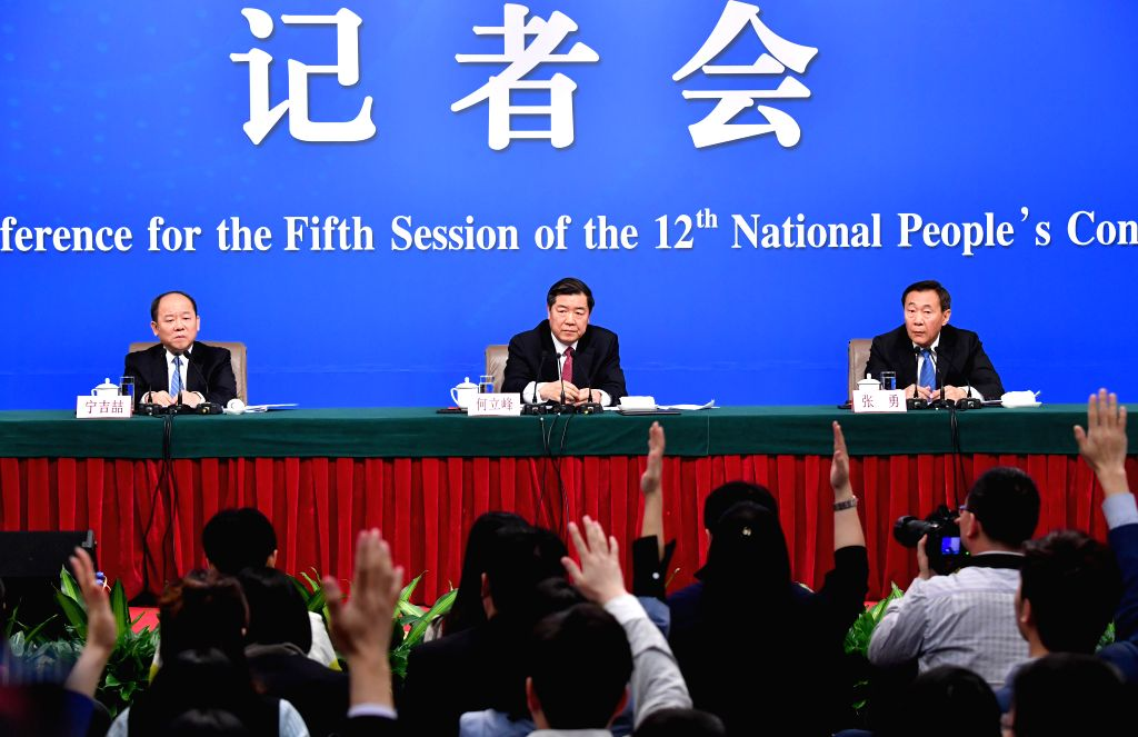 BEIJING, March 6, 2017 - Director of the National Development and Reform Commission (NDRC) He Lifeng, vice directors of the NDRC Zhang Yong and Ning Jizhe, take questions during a press conference on ...