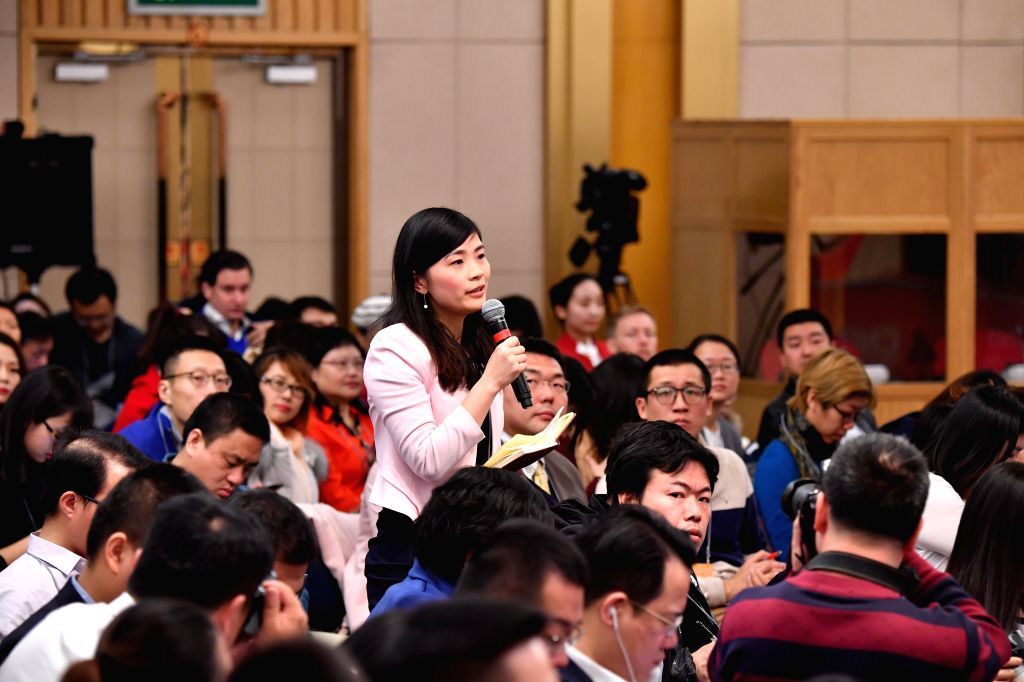 BEIJING, March 7, 2017 - A journalist raises questions to Chinese Minister of Finance Xiao Jie and Assistant Minister Dai Bohua during a press conference on reform of fiscal and taxation system and ... - Dai Bohua