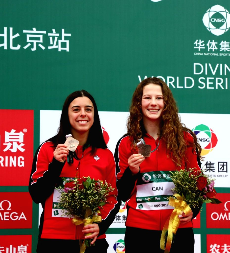 BEIJING, March 7, 2019 - Bronze medalists Meaghan Benfeito (L) / Caeli Mckay of Canada pose during the awarding ceremony for the women's 10m Platform Synchro Final at the FINA Diving World Series ...
