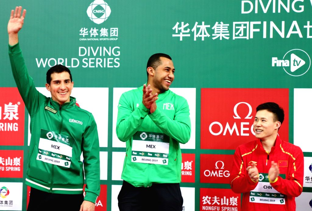 BEIJING, March 7, 2019 - Gold medalist Xie Siyi (R) of China, silver medalists Jahir Ocampo Marroquin (C)/Rommel Pacheco Marrufo of Mexico celebrate on the podium during the awarding ceremony of the ...