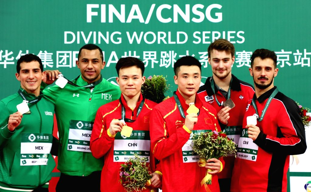 BEIJING, March 7, 2019 - Gold medalists Cao Yuan (3rd R)/Xie Siyi (3rd L) of China, silver medalists Jahir Ocampo Marroquin (2nd L)/Rommel Pacheco Marrufo (1st L) of Mexico and bronze medalists ...