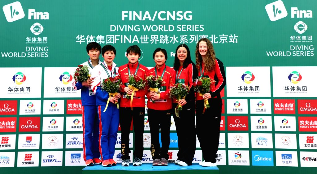 BEIJING, March 7, 2019 - Gold medalists Lu Wei (3rd R)/Zhang Jiaqi (3rd L) of China , silver medalists Kim A Rim (2nd L)/Kim Mi Rae (1st L) of the Democratic People's Republic of Korea (DPRK) and ...