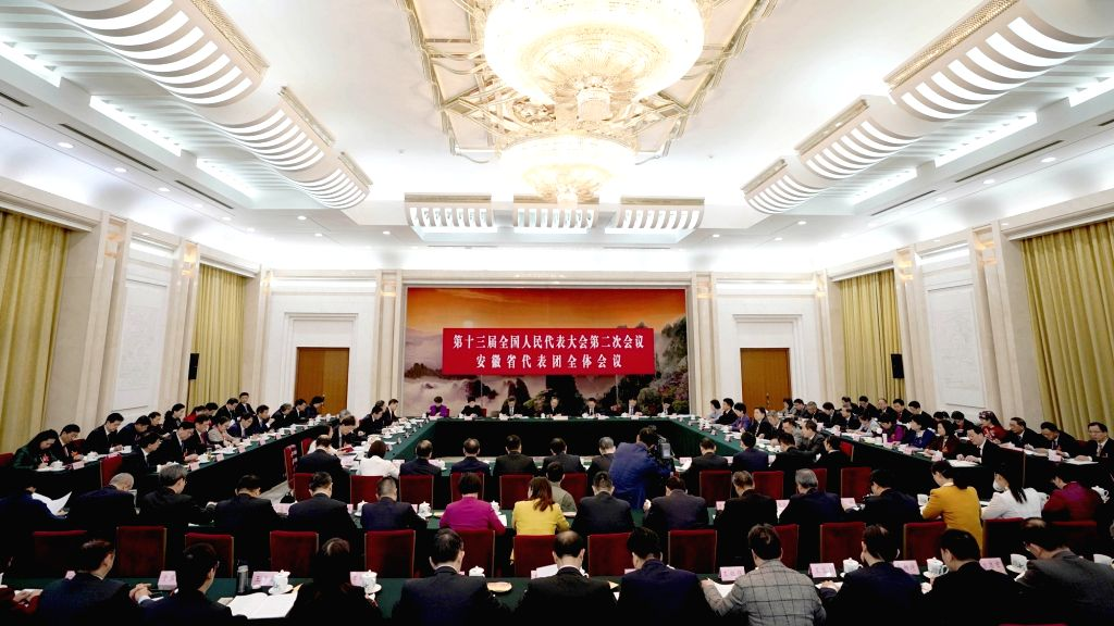 BEIJING, March 7, 2019 - Photo taken on March 7, 2019 shows the scene of a plenary meeting of deputies from Anhui Province at the second session of the 13th National People's Congress in Beijing, ...