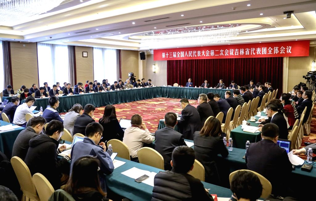 BEIJING, March 7, 2019 - Photo taken on March 7, 2019 shows the scene of a plenary meeting of deputies from Jilin Province at the second session of the 13th National People's Congress in Beijing, ...