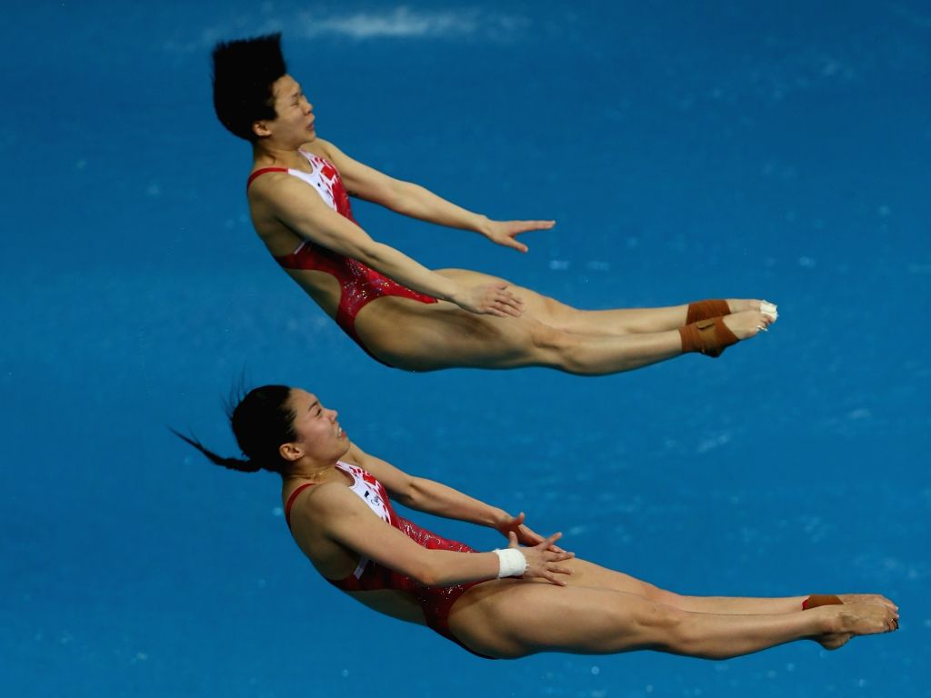 BEIJING, March 7, 2019 - Shi Tingmao (top)/Wang Han of China compete during the women's 3m synchronised springboard final of the FINA Diving World Series 2019 at the National Aquatics Center in ...