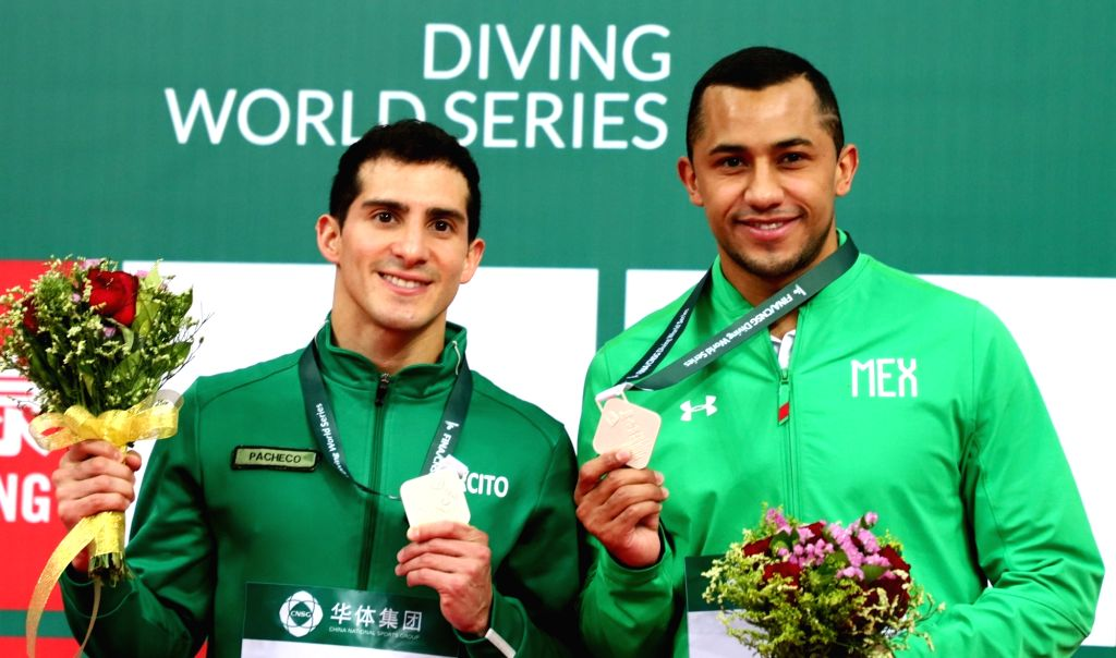 BEIJING, March 7, 2019 - Silver medalists Jahir Ocampo Marroquin (R)/Rommel Pacheco Marrufo of Mexico pose during the awarding ceremony of the men's 3m synchro springboard final at the FINA Diving ...