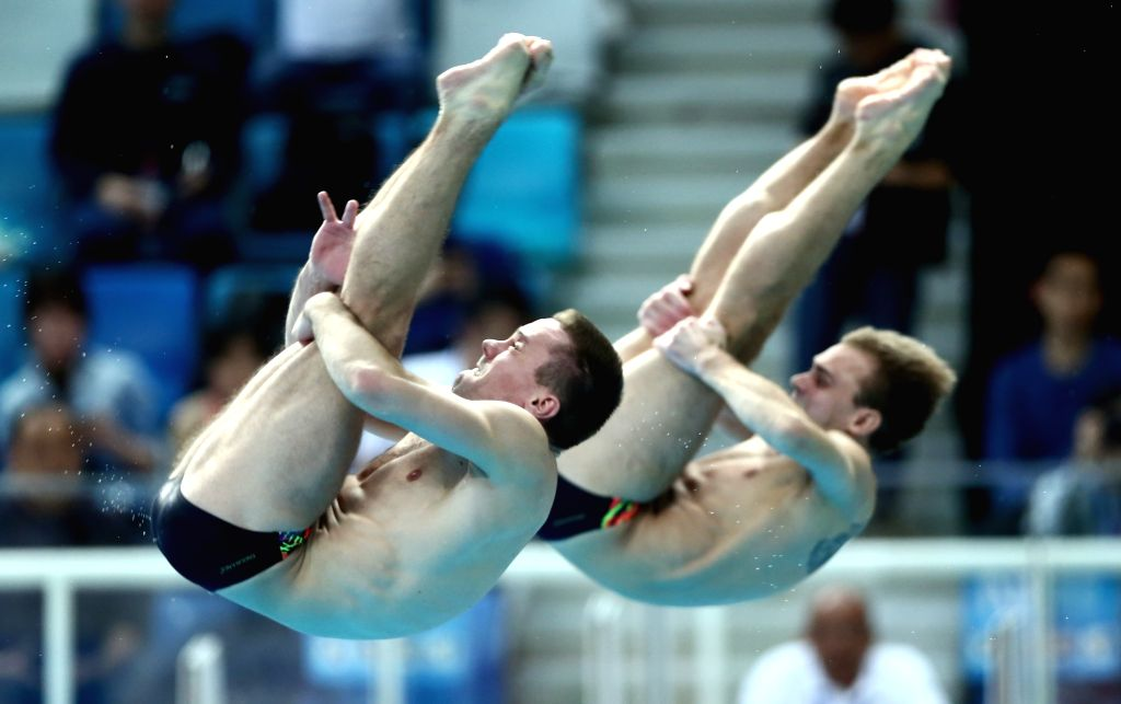 BEIJING, March 7, 2019 - Ukraine's Oleksandr Gorshkovozov/Oleg Kolodiy (R) compete during the men's 3m synchro springboard final at the FINA Diving World Series 2019 at the National Aquatics Center ...