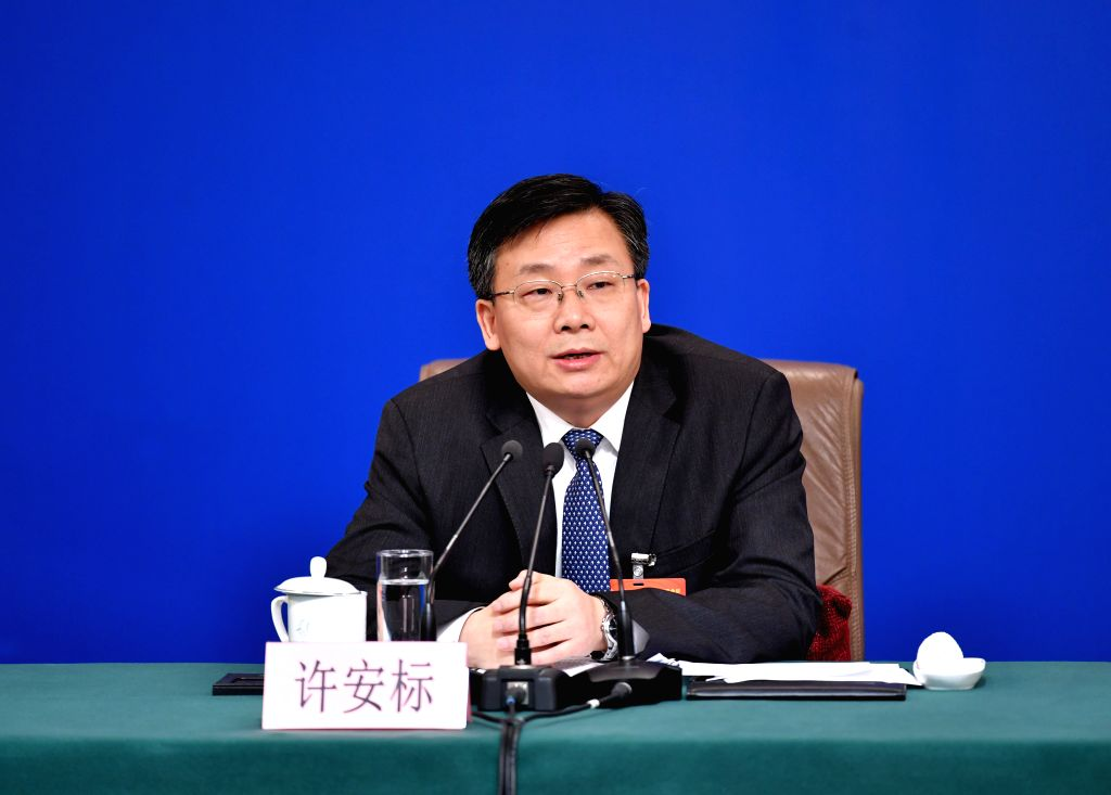 BEIJING, March 9, 2019 - Xu Anbiao, vice chairman of Legislative Affairs Commission of the National People's Congress (NPC) Standing Committee, attends a press conference on the legislative work of ...