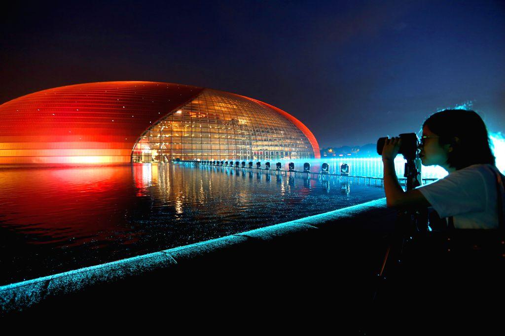 BEIJING, May 13, 2017 - A photographer takes photos of the National Centre for the Performing Arts in Beijing, capital of China, May 12, 2017. Landscape lighting will illuminate Beijing in the ...