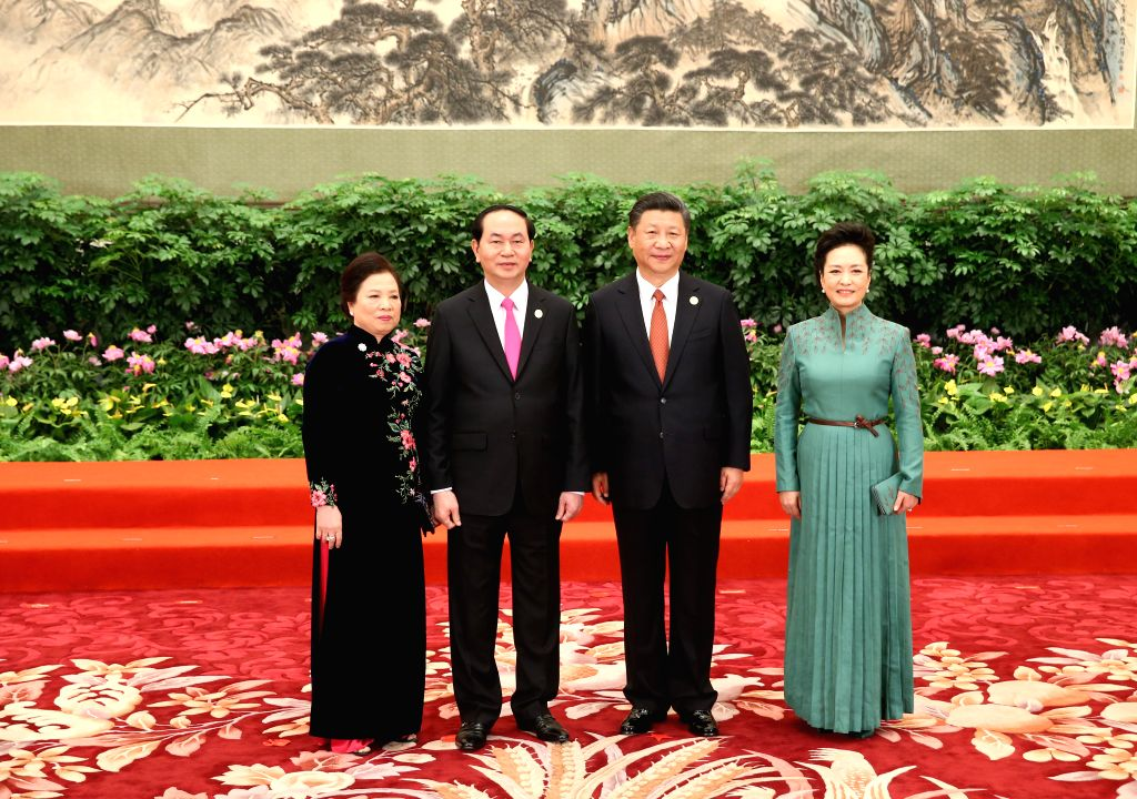 BEIJING, May 14, 2017 - Chinese President Xi Jinping and his wife Peng Liyuan welcome Vietnamese President Tran Dai Quang and his wife before a banquet for the Belt and Road Forum (BRF) for ...