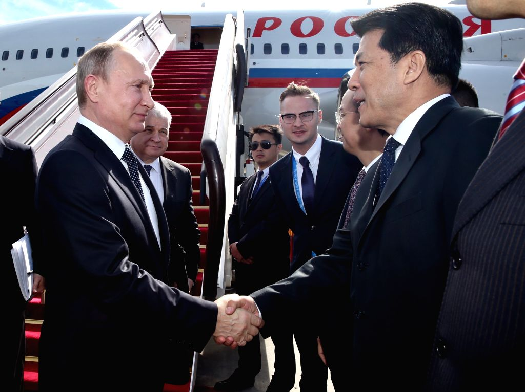 BEIJING, May 14, 2017 - Russian President Vladimir Putin (L) arrives in Beijing, capital of China, May 14, 2017, to attend the Belt and Road Forum (BRF) for International Cooperation.