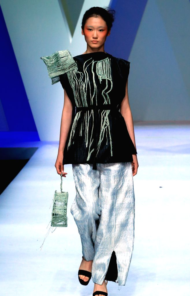 BEIJING, May 15, 2017 - A model presents a creation designed by graduate of fashion design department of Zhejiang University of Science & Technology during the China Graduate Fashion Week in ...