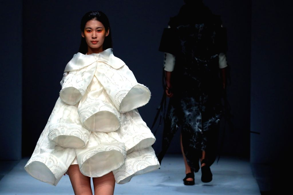 BEIJING, May 21, 2017 - Models present fashion creations designed by graduates of Southwest University during the China Graduate Fashion Week in Beijing, capital of China, May 20, 2017.