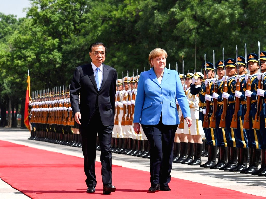 BEIJING, May 24, 2018 - Chinese Premier Li Keqiang holds a welcome ceremony for visiting German Chancellor Angela Merkel, before their talks at the Great Hall of the People, in Beijing, capital of ...