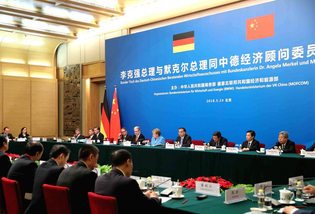 BEIJING, May 24, 2018 - Chinese Premier Li Keqiang and visiting German Chancellor Angela Merkel attend a meeting of China-German Economic Advisory Committee at the Great Hall of the People, in ...