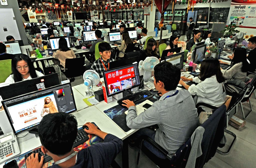 BEIJING, May 7, 2019 (Xinhua) -- Staff members work at an e-commerce service company in Yiwu, east China's Zhejiang Province, on Oct. 25, 2018.  China's digital economy reached 31.3 trillion yuan (4.6 trillion U.S. dollars) in 2018, accounting for 34