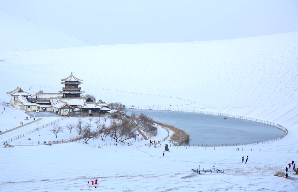 BEIJING, May 9, 2019 - Photo taken on Dec. 2, 2018 shows the snow scenery of the Mingsha Mountain and Crescent Spring scenic area in Dunhuang, northwest China's Gansu Province. China will hold the ...