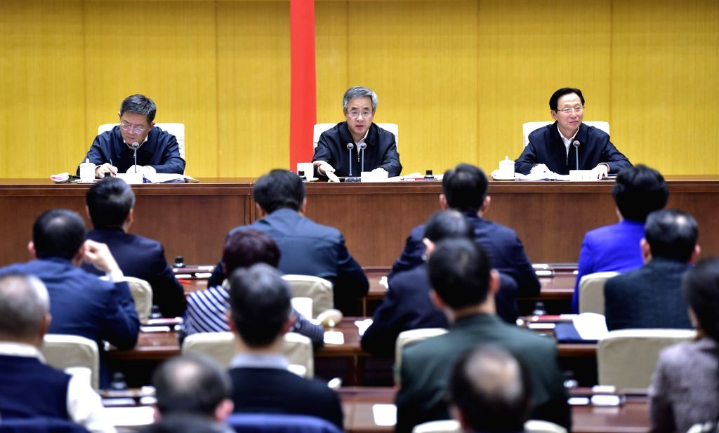 BEIJING, Nov. 1, 2018 - Chinese Vice Premier Hu Chunhua (C, back), also a member of the Political Bureau of the Communist Party of China Central Committee, speaks at a teleconference on combating the ...