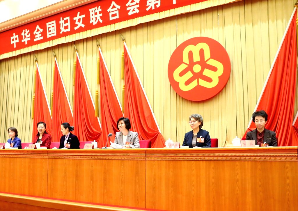 BEIJING, Nov. 1, 2018 - Shen Yueyue (3rd R) is re-elected president of the All-China Women's Federation (ACWF) at the first plenary meeting of the 12th executive committee of the ACWF in Beijing, ...