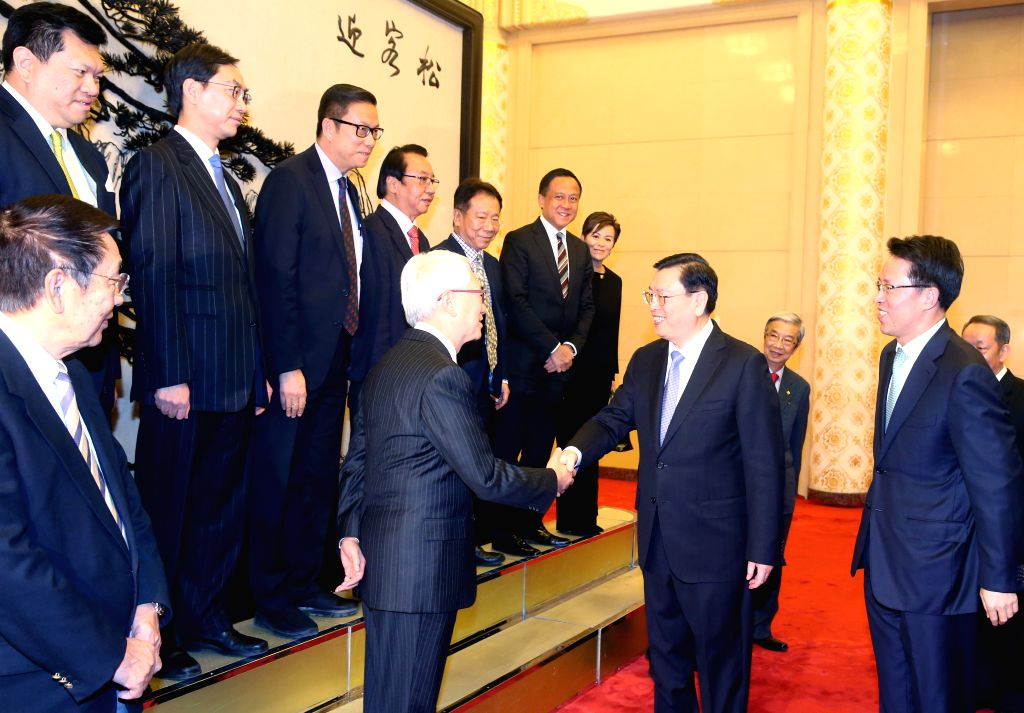 BEIJING, Nov. 29, 2016 - Zhang Dejiang (2nd R, front), chairman of the Standing Committee of China's National People's Congress, meets with a visiting Hong Kong delegation, Silent Majority for Hong ...