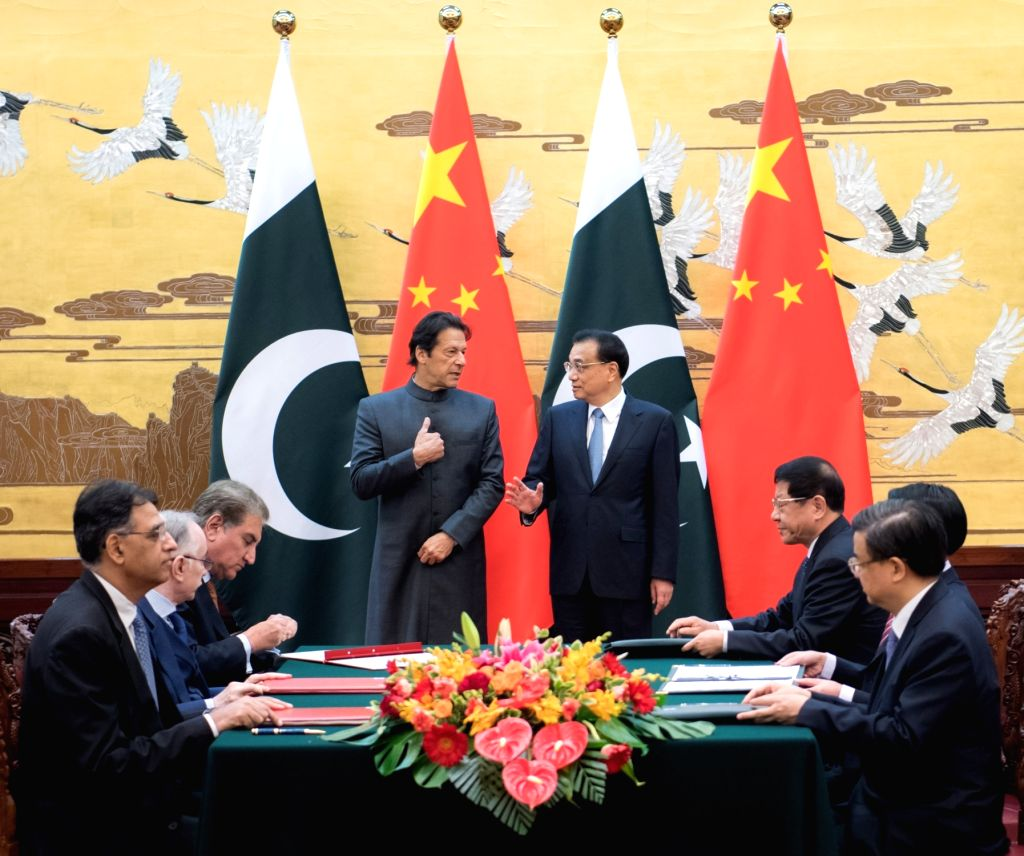 BEIJING, Nov. 3, 2018 - Chinese Premier Li Keqiang (R, back) and Pakistani Prime Minister Imran Khan (L, back), who is paying an official visit to China, witness the signing of more than 10 documents ... - Imran Khan