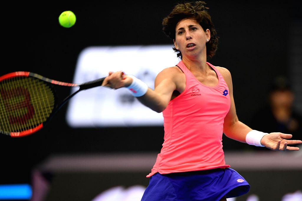BEIJING, Oct. 1, 2017 - Carla Suarez Navarro of Spain returns a shot during the women's singles first round match against Karolina Pliskova of the Czech Republic at 2017 China Open in Bejing, capital ...