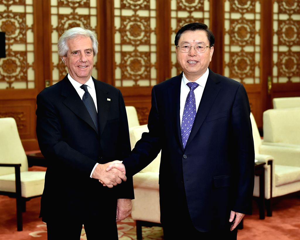 BEIJING, Oct. 19, 2016 - Zhang Dejiang (R), chairman of the Standing Committee of the National People's Congress (NPC), meets with Uruguayan President Tabare Vazquez at the Great Hall of the People ...