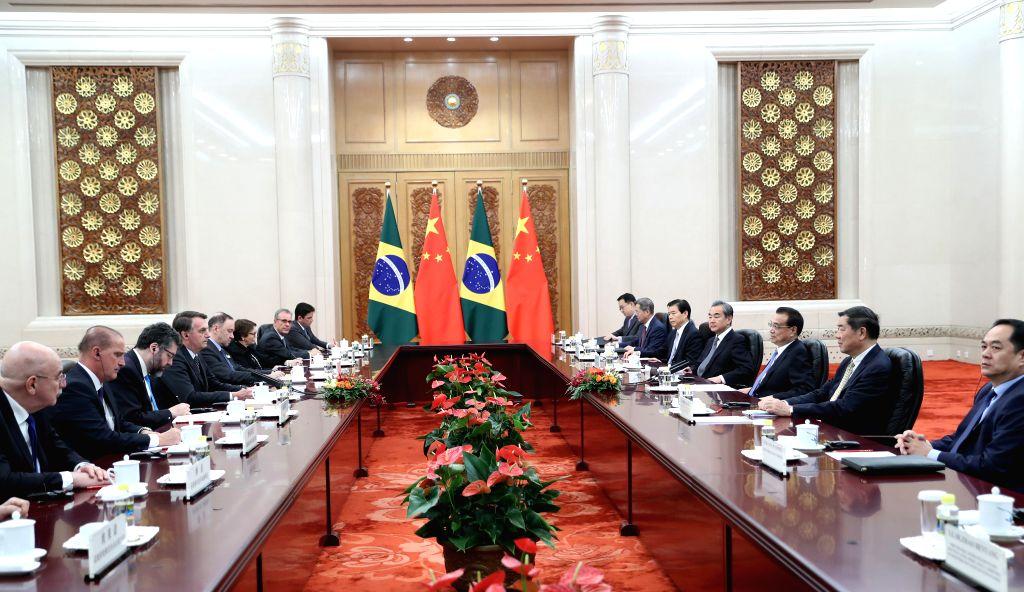 BEIJING, Oct. 25, 2019 - Chinese Premier Li Keqiang meets with Brazilian President Jair Messias Bolsonaro in Beijing, capital of China, Oct. 25, 2019.