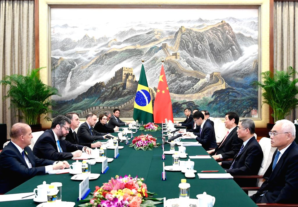 BEIJING, Oct. 25, 2019 - Li Zhanshu, chairman of the Standing Committee of the National People's Congress (NPC), meets with Brazilian President Jair Messias Bolsonaro at the Great Hall of the People ...