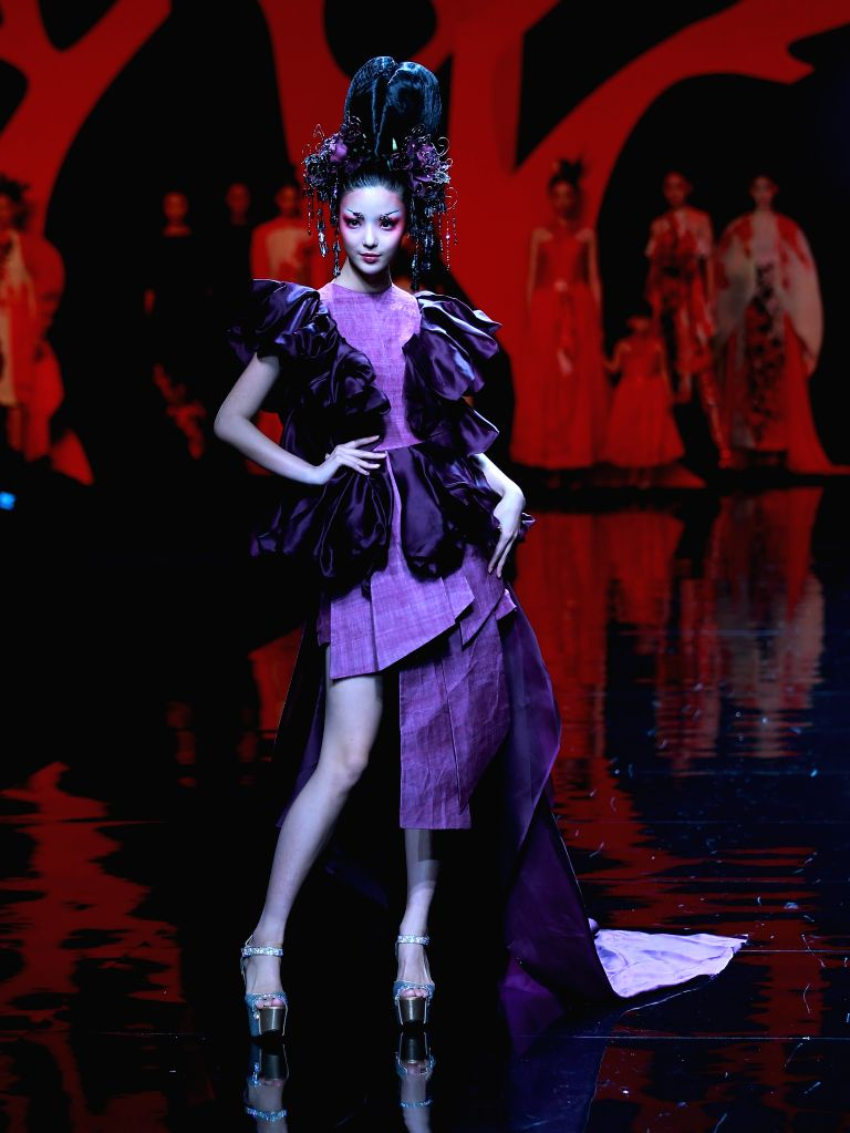 BEIJING, Oct. 28, 2016 - A model presents a creation by designer Zhang Yichao during the China Fashion Week in Beijing, capital of China, Oct. 27, 2016.