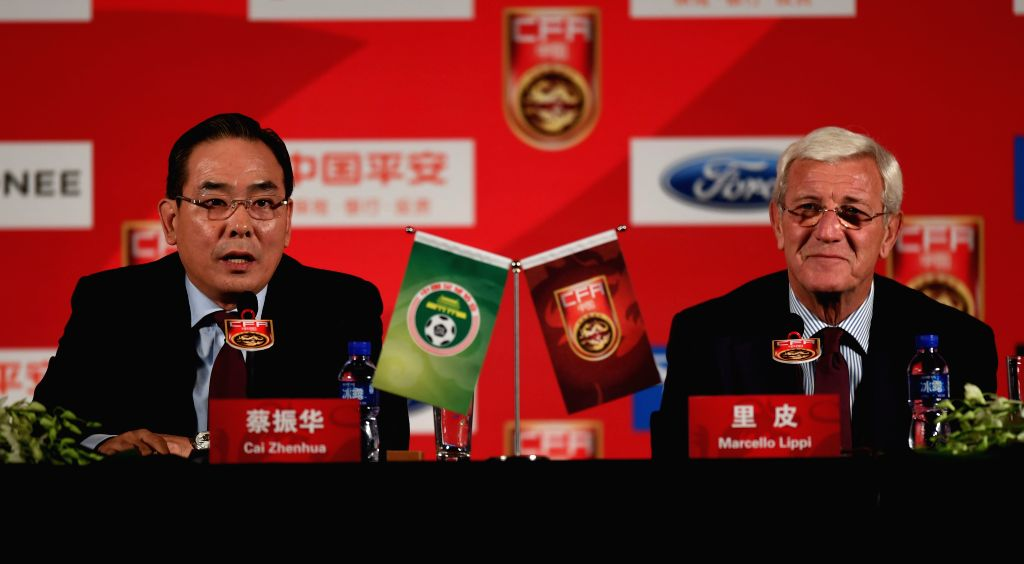BEIJING, Oct. 28, 2016 - Marcello Lippi (R), newly appointed China's national football team head coach, attends a press conference with Cai Zhenhua, president of the Chinese Football Association ...