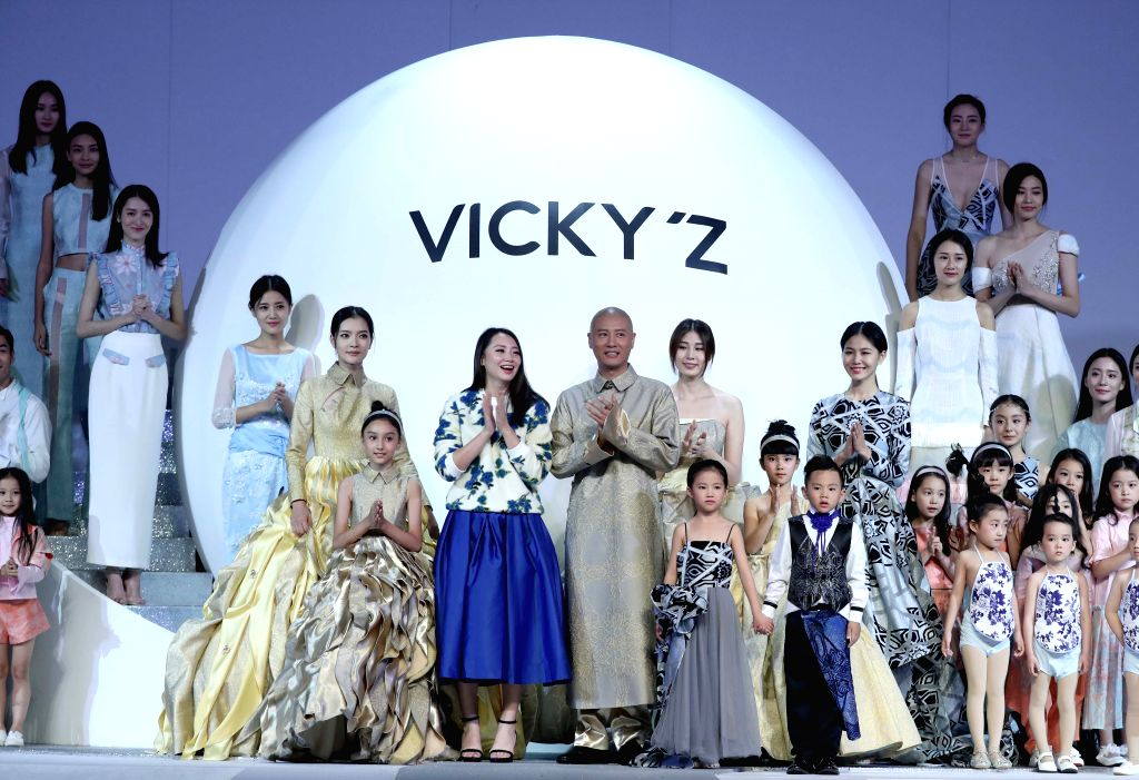 BEIJING, Oct. 29, 2016 - Models present the parent-child outfits designed by Xu Xinyin during the China Fashion Week in Beijing, capital of China, Oct. 29, 2016.
