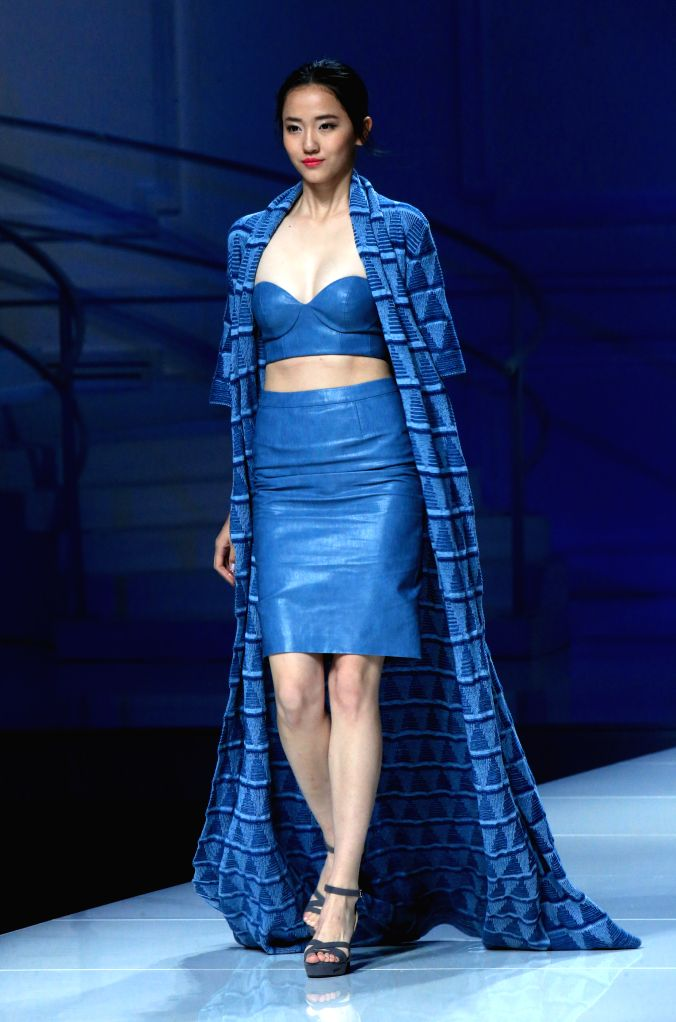 BEIJING, Oct. 31, 2016 - A model presents a creation during the China Fashion Week in Beijing, capital of China, Oct. 30, 2016.