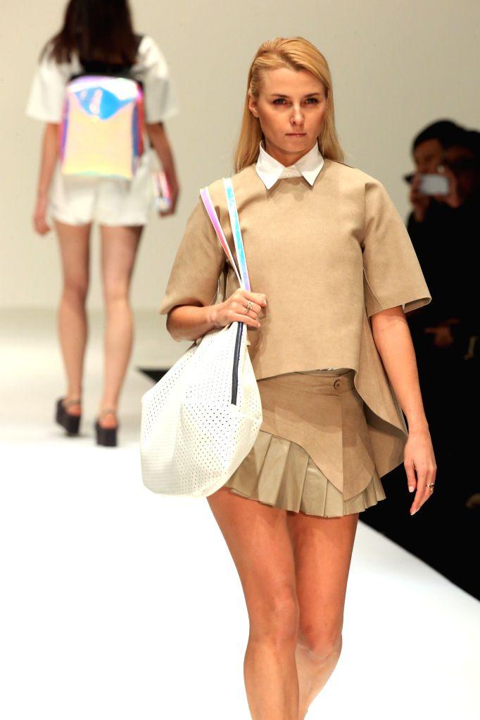 BEIJING, Oct. 31, 2016 - A model presents a handbag creation by designer Liu Shengyi during the China Fashion Week in Beijing, capital of China, Oct. 30, 2016.