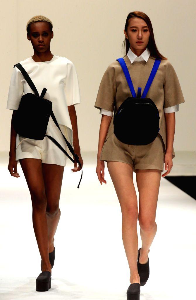 BEIJING, Oct. 31, 2016 - Models present handbag creations by designer Liu Shengyi during the China Fashion Week in Beijing, capital of China, Oct. 30, 2016.