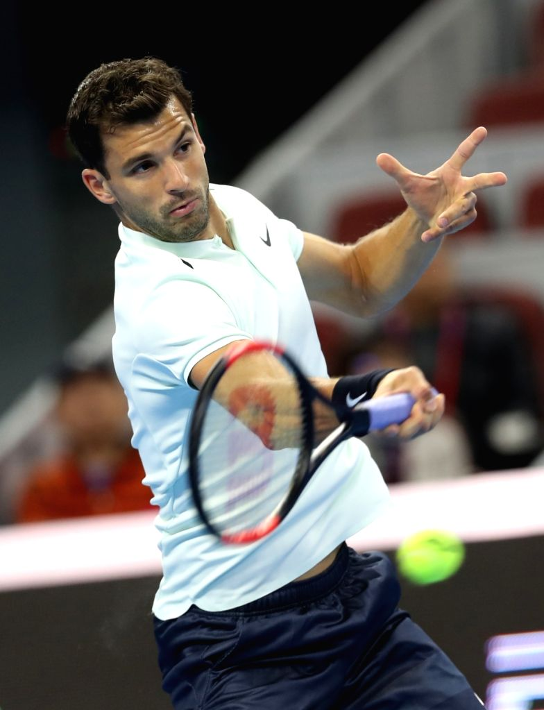 BEIJING, Oct. 4, 2017 - Grigor Dimitrov of Bulgaria returns the ball during the men's singles second round match against Juan Martin del Potro of Argentina at 2017 China Open tennis tournament in ...