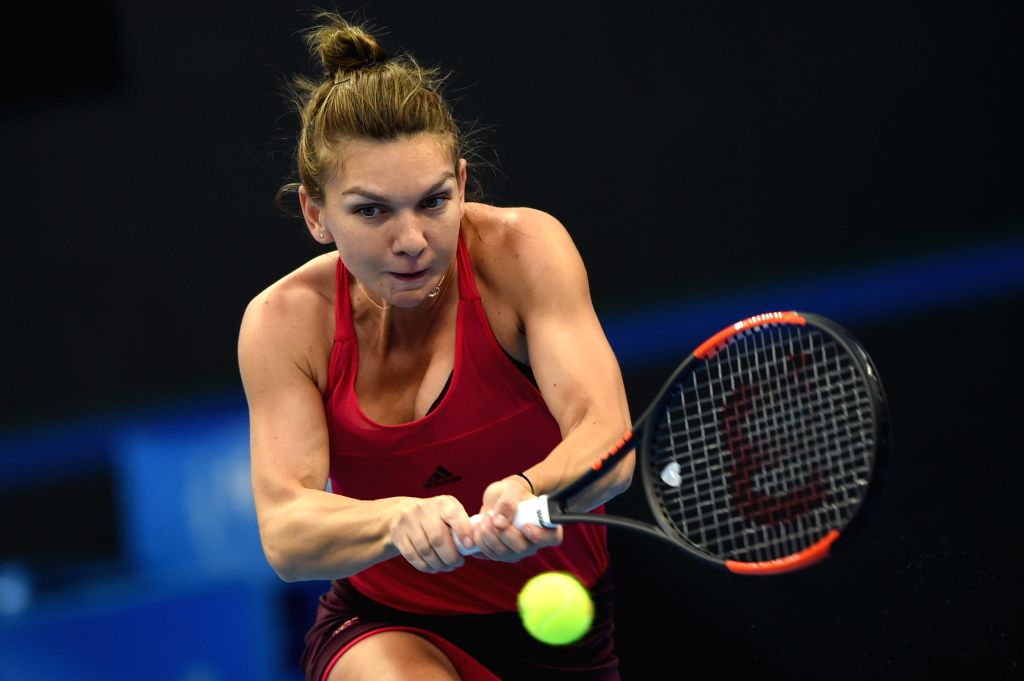 BEIJING, Oct. 4, 2017 - Simona Halep of Romania returns the ball during the women's singles third round match against Maria Sharapova of Russia at 2017 China Open tennis tournament in Beijing, ...